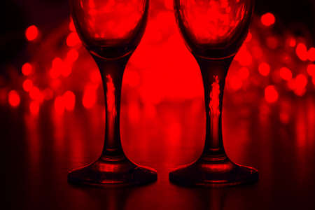 Wineglasses on blurred background. romantic concept