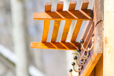 Clothes hooks on a wooden plaque. Outdoor Archivio Fotografico