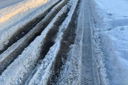 Melting snow on a road. Dangerous road. Close up Archivio Fotografico