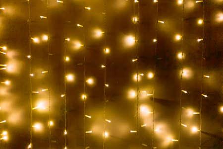 Blurred garland lights background. Christmas lights Archivio Fotografico