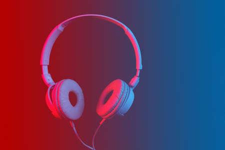 headphones on dark background in neon light