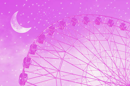 Vintage photo with ferris wheel against the moon colorful sky