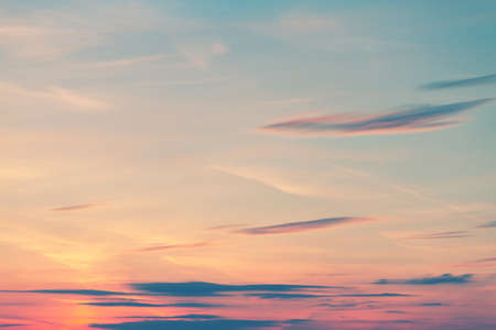 Beautiful cloudscape at sunrise. Blue sky and pinky clouds