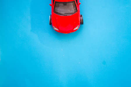 Red toy car with copy space