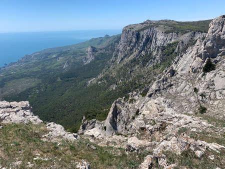 Landscape with mountain peaks and rocks. Sea below 版權商用圖片