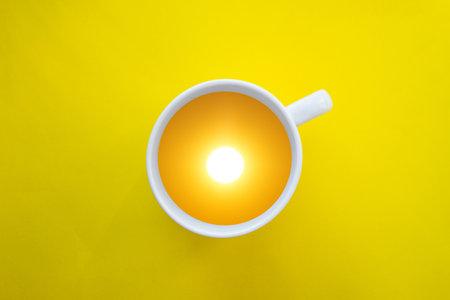 Fantasy image with sun inside a mug