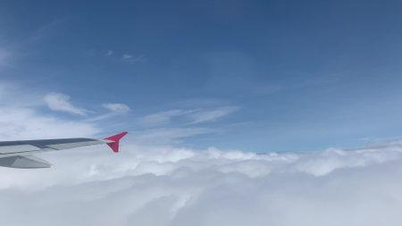 Blue sky view from aircraft window Zdjęcie Seryjne