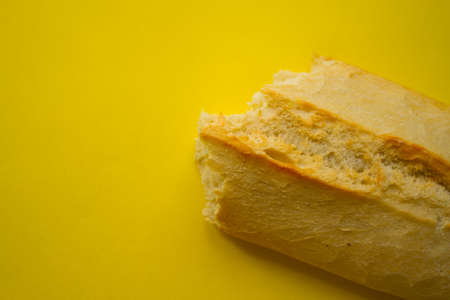 Bread with copy space on yellow background