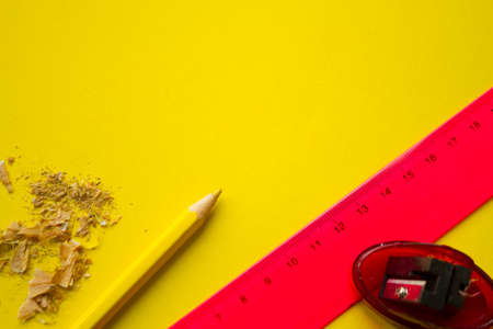 Yellow pencil on yellow background with copy space