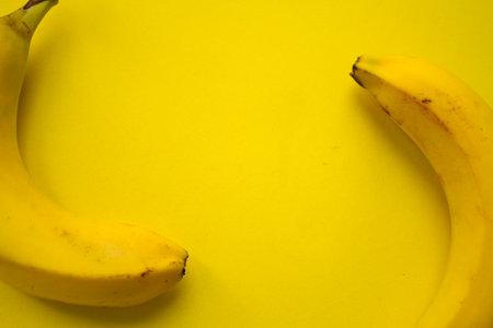 Yellow bananas on yellow background. Copy space Zdjęcie Seryjne