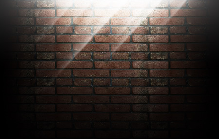 background of brick teny with rays of light Stock Photo