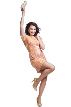 she: Girl in full growth. She is standing on one leg. Dancing. isolate