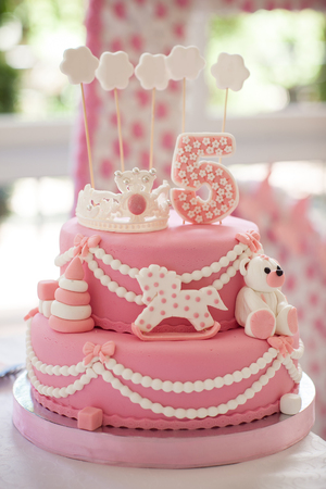 5 years old: pink birthday cake. The girl was 5 years old