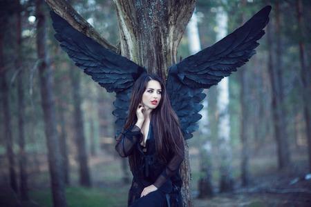 speculative: dark fairy in the woods. Blue tone picture