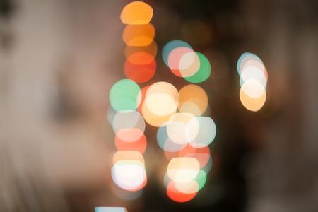 colorful blurred reflections of fur-tree garlands on the back burner