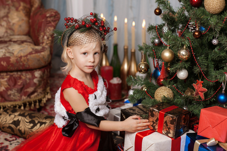 Girl in a red dress in a New Years interior