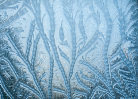 burnish: Winter Frosty patterns on the cold window Stock Photo