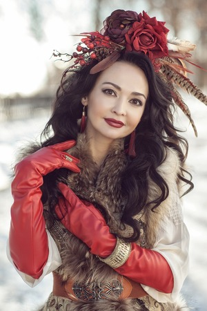 furs: The girl in furs and red clothes. winter