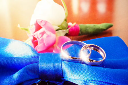 Wedding set. Rings, tie, boutonniere Stock Photo