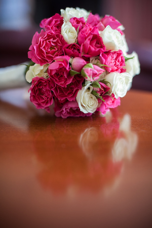 white fabric texture: wedding bouquet lies on a wooden table Stock Photo