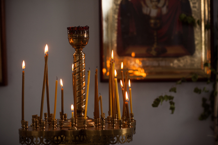 serbia xmas: Many Russian candles in the church. Icons in the background