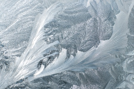 Frosty patterns on glass in winter