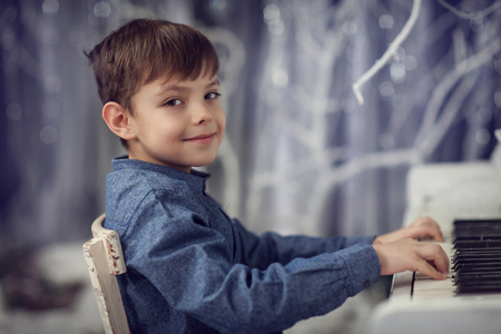 The boy at the white piano