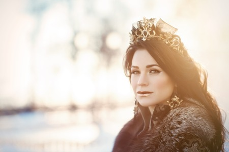 portrait of a brunette in furs in a winter frosty day Editorial