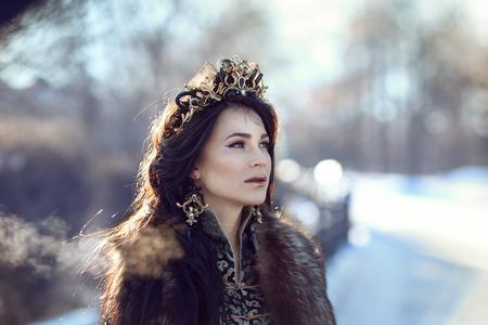 furs: Portrait of a brunette in furs in a winter frosty day