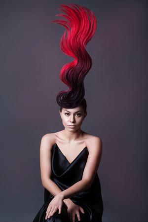 studio portrait of a woman with a fantasy fiery hairdo