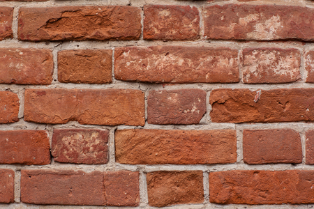 wall of old red brick. The middle plan. Horizontal frame