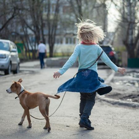 girl dancing with dog
