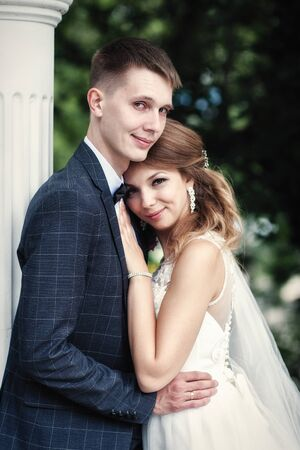 portrait of the newlyweds in the park