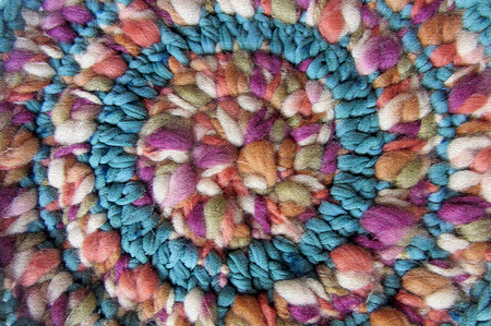 woollen: Colorful wool. Abstract multicolor texture background. Handmade crocheted pattern. Image of braided multi colored woollen yarns. Decorative mandala reproduction. Stock Photo