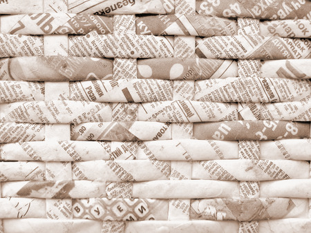 weaving: Twisted weaving newspapers. Abstract texture with cyrillic letters.