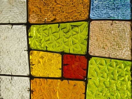 stained glass church: Abstract geometric colorful background. Image of a multicolored stained glass church window with irregular random block pattern, square format. Decorative window of various colored rectangles. Stock Photo