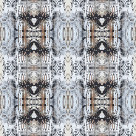 Decorative seamless pattern based on ethnic motifs with exquisite wooden texture in monochrome colors. Stock Photo