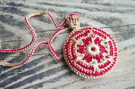 exclusive photo: Handmade accessories in ethnic style on wooden table. Crochet homemade things. Crochet pattern. Handicraft manufacturing. Stock Photo