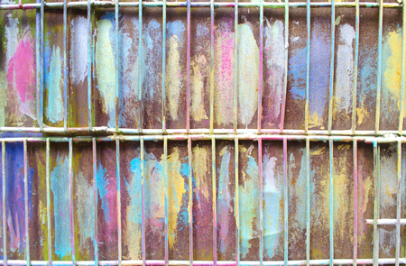 The metal lattice is painted in bright colors. Stock Photo
