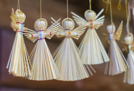 Traditional handmade straw doll gift. Decorative angel figure.