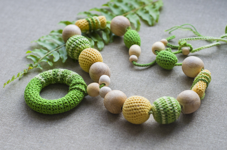 Necklace made from knitted beads and toys for the baby sitting in a sling. Knitted beads. Sling necklace. 版權商用圖片