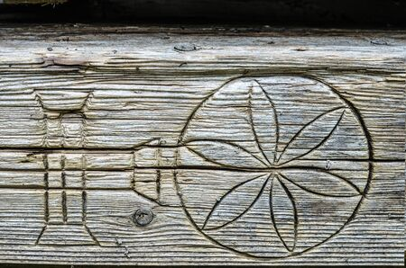 Carved wooden antique texture .Ethnic background. The symbol is the flower of life.Ukrainian architecture.