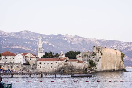 Budva bay. The view at the medieval citadel. Panoramic view. Medieval cities in the Mediterranean. Resort of Adriatic Riviera.