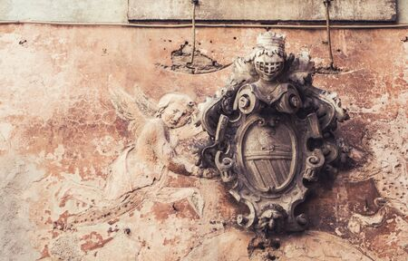 Architectural detail of cartouche angel fresco. Vintage photo with place for text.
