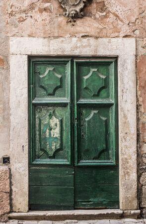 Green medieval door in old town. Mysterious emerald door photo of Kotor