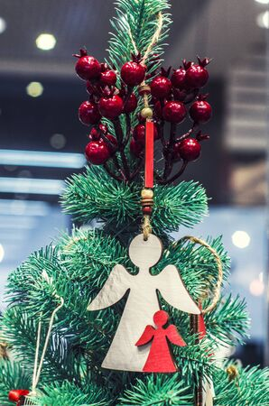 Wooden angel on the background of Christmas tree. Christmas decor. Greeting banner, postcard, 스톡 콘텐츠