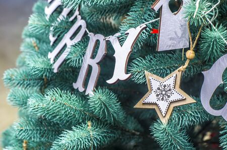 Merry Christmas and Happy New Year festive card. Christmas fir tree decoration . Holiday composition. Festive background.