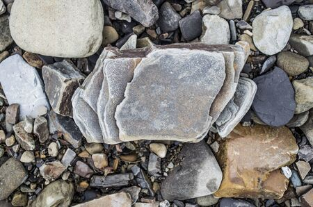 Stone rock fragment on the bank of a mountain river. Natural photo.