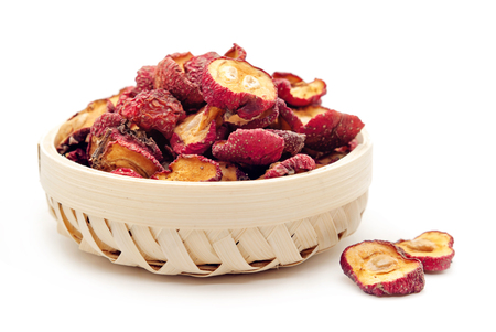 Dried hawthorn slices for brewing tea on white background Stock Photo