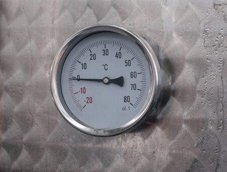 Circle thermometer measure on metal